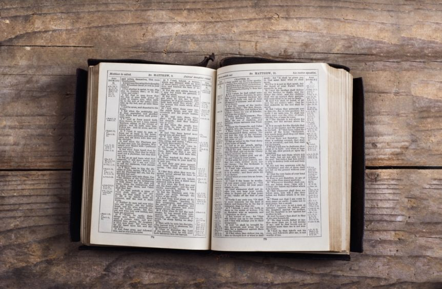 Bible on a wooden desk